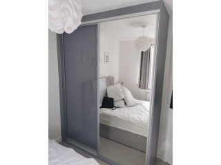 Fitted sliding door wardrobe designed and made to measure for our customer