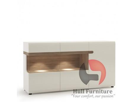 Abbie - 3 Door Glazed Sideboard in white with an Truffle Oak Trim in white high gloss MDF with an Truffle Oak trim.